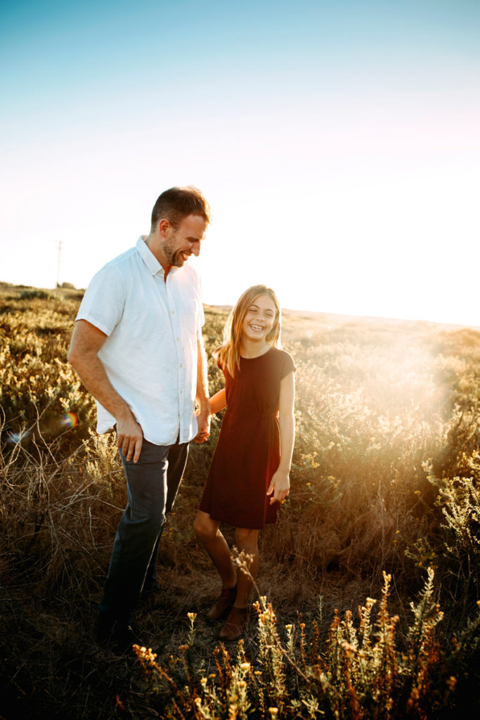 San Diego Family Photography, father and daughter smiling and walking through a field