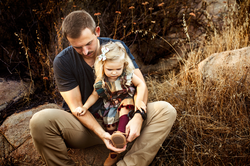 San Diego Family Photography, father helping young daughter put her shoe on